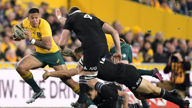 Folau makes a break with Brodie Retallick in pursuit during the Bledisloe Cup test in Sydney on Saturday.