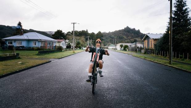 Jerome Ratahi,13, does wheelies down Reu St on his red BMX. He moved to Taumarunui from Kawerau with his mum and siblings.