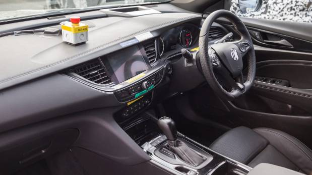 """Interior style similar to smaller Astra. You push the big red button if anybody says """"rear-drive""""."""