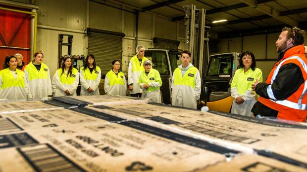 McCain cool store manager Gary Jarvis (right) talks to school students visiting the plant on Thursday.