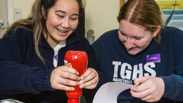 Ebony Keely (left) and Annabell Manson get to taste the finished product at McCain on Thursday.