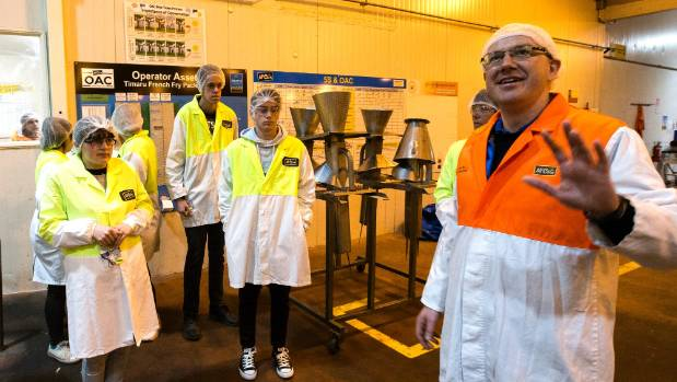 McCain plant manager Gordon Gillies shows students around the plant on Thursday.