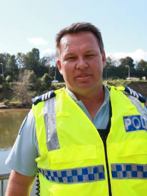 Cambridge police Sergeant Andrew Osborn at the Waikato River scene on Thursday, where police divers worked to recover ...