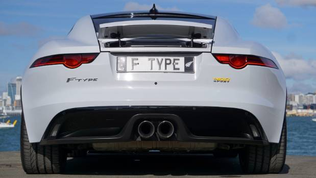 The business end: deployable spoiler and central exhaust pipes standard on 400 Sport.