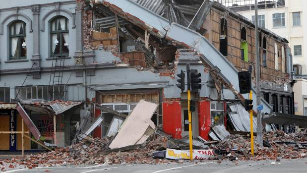 Damage in Christchurch following the 2011 earthquake including a collapsed building on the intersection of Tuam And ...
