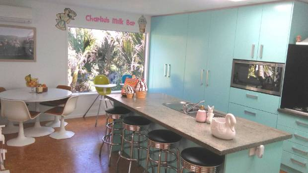 Yolanda O'Neill's homemade kitchen with concrete benchtops and painted MDF cabinets.