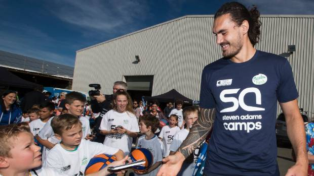 Adoring fans line up for autographs in Christchurch on Friday.