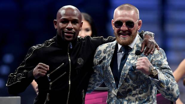 ETHAN MILLER  GETTY IMAGES Floyd Mayweather Jr and Conor Mc Gregor pose for