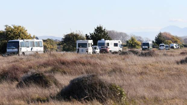 Whitebaiters park their camper vans on the banks of the Wairau Diversion in Marlborough.