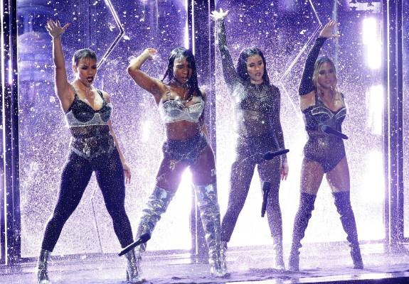 Fifth Harmony drop their microphones as they perform.
