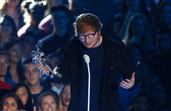 Singer Ed Sheeran accepts the the Artist of the Year award.