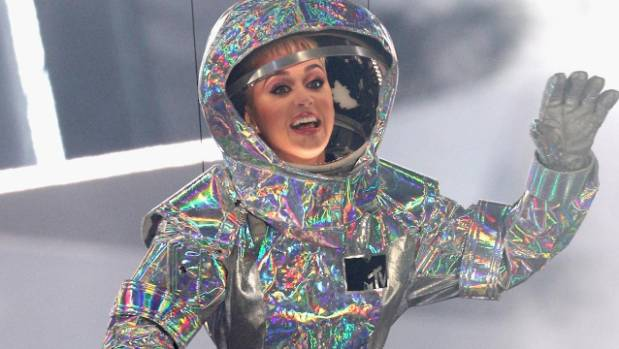 Katy Perry gets stuck mid-air on planet prop during concert