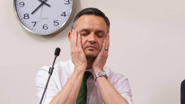 Green Party candidate James Shaw gets a dousing for going overtime at the  Aro Valley 'meet the candidates' evening.
