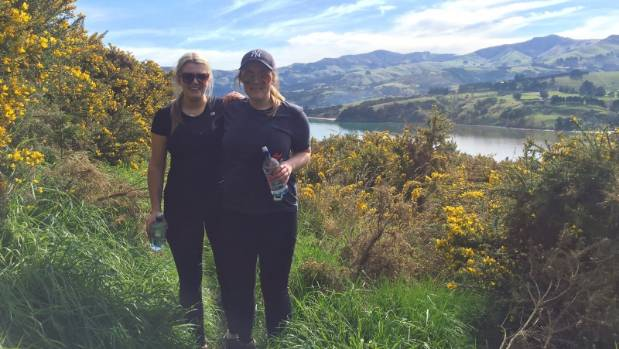 On a break from running, Maddison Northcott, left, and flatmate Madison Monk hike the Children's Bay walkway from Akaroa ...