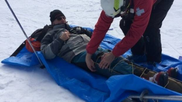 Fake fitness guru Mark Northcott being strapped by a paramedic after an accident while skiing on Mt Ruapehu.