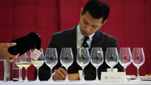 A waiter pours a Ningxia wine for a judge at a tasting event in Beijing in 2014.