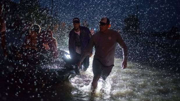 KHOU 11 crew helps rescue truck driver trapped in floodwaters