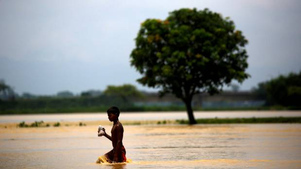 A boy walks along the flooded area in Saptari District, Nepal.