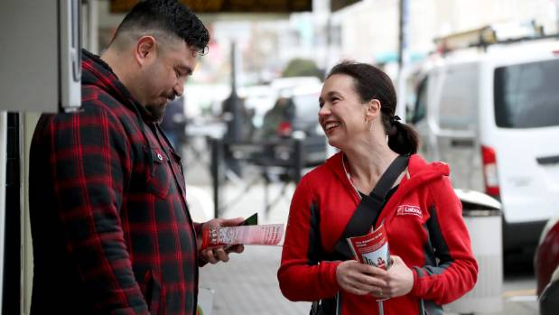 Labour Candidate Ginny Andersen speaking with Petone barber Terrence Davidson as she campaigns.