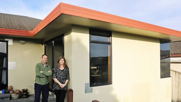 Tracey Cridge and Mark Unwin outside their leaky Wellington home which they believe is due to the use of Harditex, a ...
