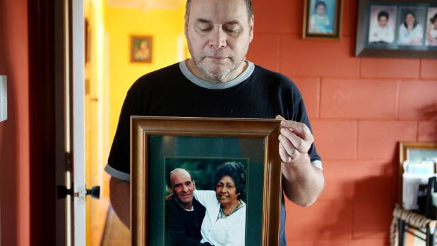 Ken Stickland with a portrait of his parents, Robert and Yvonne, who died within hours of each other.