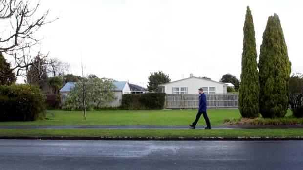 Darren Birch walks by the property on Limbrick St where he is building two Homes for People houses.