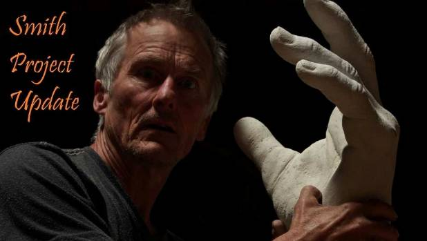 Artist Sam Mahon with a completed Nick Smith hand sculpture in April.