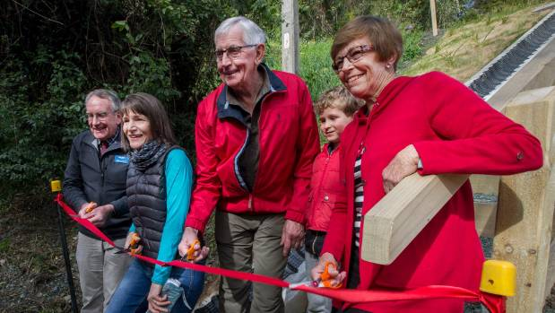 Stuart Walker, Kelly Atkinson and members of the Day family – Ray Day, Joe Moulder, 6, and Ann Moulder cut the ribbon.