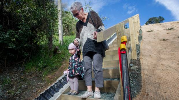 Willa McAllister, 4, enjoys the the reopened Days Track with her grandmother, Ruth Allison.