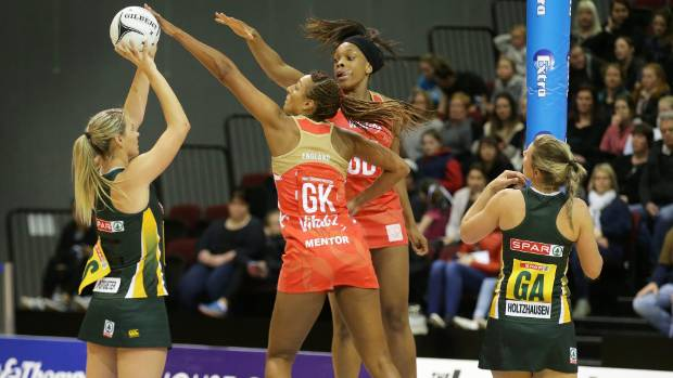 South Africa's Lenize Potgieter shoots despite the attention of England GK Geva Mentor and GD Ama Agbeze, while South ...