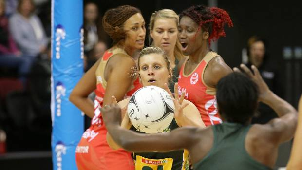 South African goal attack Maryka Holtzhausen takes a pass from team mate Bongiwe Msomi against England.
