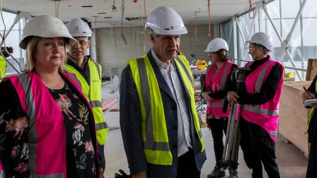 Developer Philip Carter, centre, checks out progress at The Crossing.
