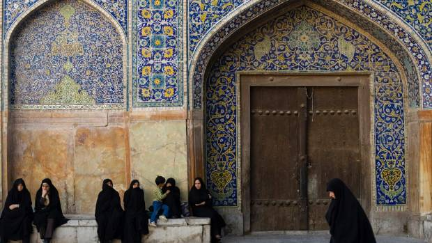 Women arrive at Naghsh e Jahan square for the festival of Eid-al-Fitr in Isfahan.
