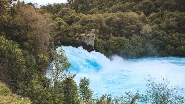 Up to 220,000 litres of water a second tumbles over the mighty Huka Falls.