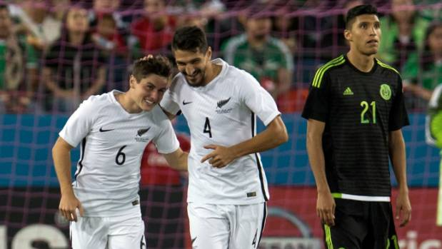 Marco Rojas celebrates his goal against Mexico with team-mate Themi Tzimopoulos last October.