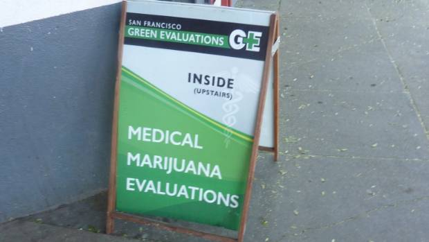 A sandwich board advertising medical marijuana evaluations.