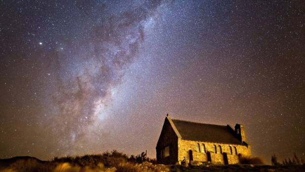 Tekapo's Church of the Good Shepherd against a backdrop of stars.