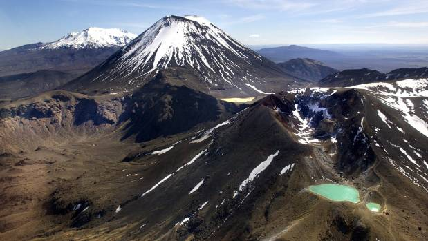 Hike the Tongariro Crossing at night, and you could have the volcanoes and sulfurous lakes to yourself.