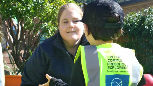 Pelorus Community Preschool's Javen Chin, 3, chats to Sanford's Ros King about the new safety vests the firm donated.
