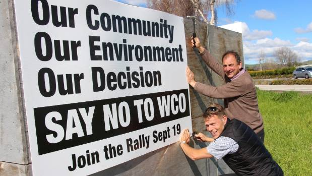 Hawke's Bay orchardists Jerf Van Beek and Brian McClay put up signs ahead of rally opposing an application for a Water ...