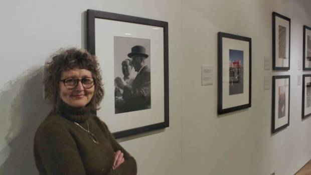 Percy Thompson Gallery director Rhonda Bunyan stands beside a photo taken by Brian Brake of Chairman Mao and soviet head ...