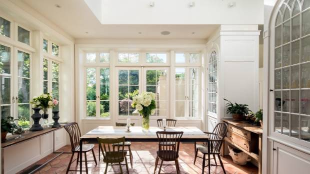 The home has numerous dining areas, including this light-filled breakfast solarium.
