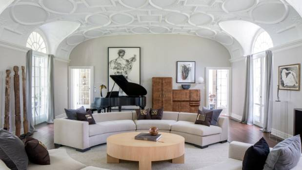 """The large living room, located on the mansions """"entertaining floor"""" is connected to a luxurious formal dining room."""