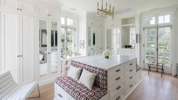 The master bedroom has a massive walk-in wardrobe and dressing room, as well as a windowed marble bathroom.