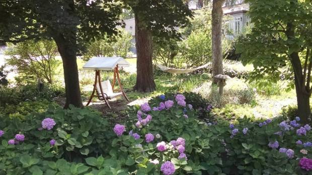 The relaxed garden surrounding the property's guest cottage shares a number of features with the version of Nick ...