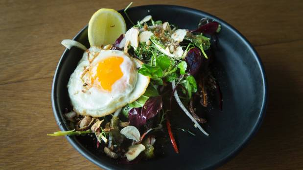 It's bacon and egg, but not as you expect: Ember's version features crispy pig's ears tossed through salad greens with a ...