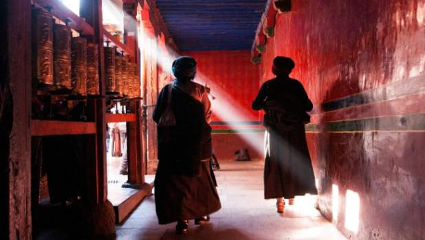 Ramocha Temple: The vivid colours of Ramocha Temple, in Lhasa, provides an extraordinary back drop for photography. Once ...