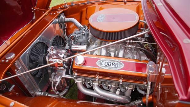 The Ford F100 sports a Cobra Jet 460 Ford big block motor.
