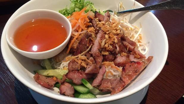 Bowl of delight: Special fried spring rolls and grilled pork on rice vermicelli.