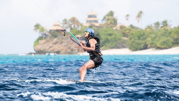 Hitting the waters of the Caribbean. Barack Obama tried his hand at kitesurfing, a favourite hobby of Branson's, during ...